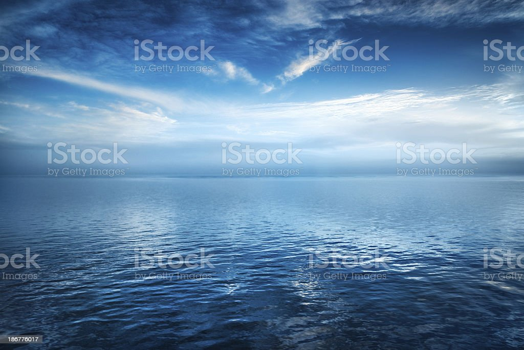 Dramatic Cloudscape Over the Deep Dark Blue Ocean royalty-free stock photo