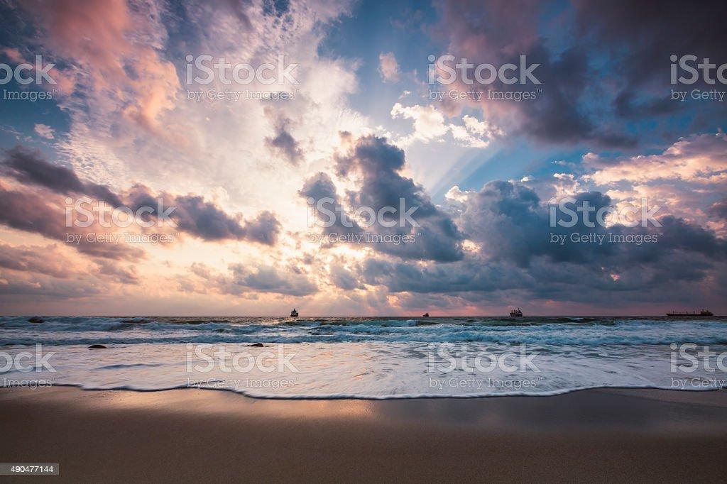Dramatic cloudscape over the sea, sunrise shot stock photo