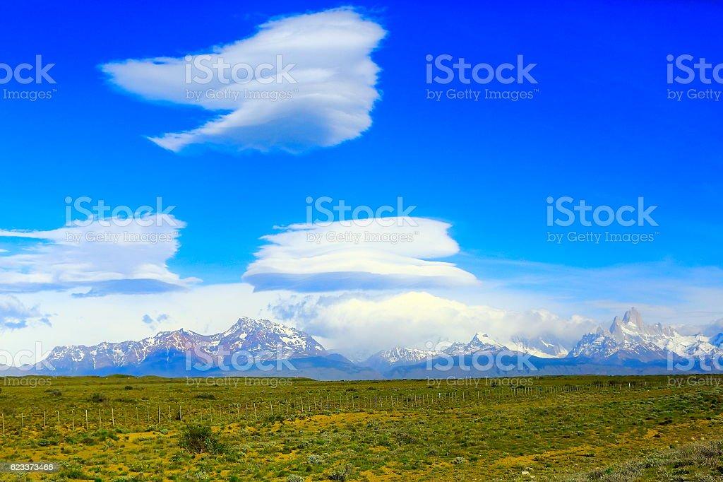 Dramatic cloudscape, Patagonia ranch, Fitz Roy massif, El Chalten, Argentina stock photo