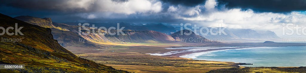 Dramatic coastal landscape epic remote Arctic Ocean mountains panorama Iceland stock photo