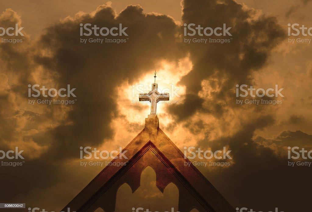 dramatic cross on a church with cloudy gloomy mood stock photo