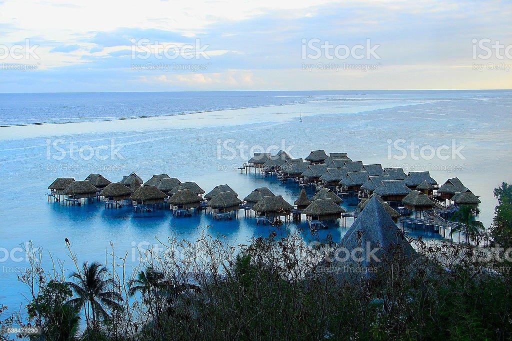 Dramatic Evening, bungalows over water, Moorea, Polynesia, Tahiti stock photo