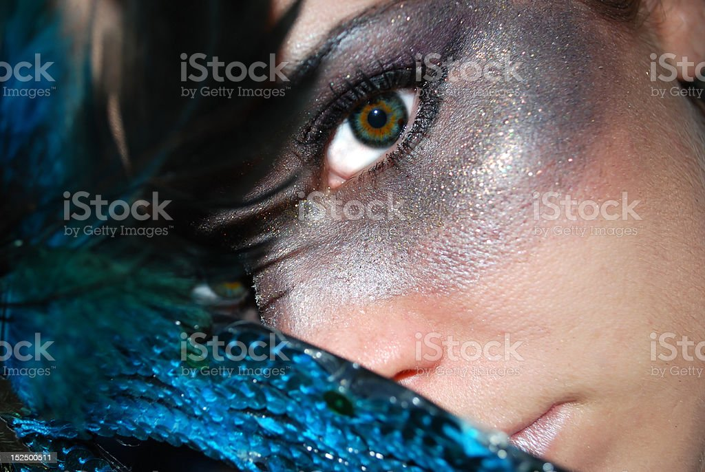 Dramatic female face with gray make-up and mask stock photo