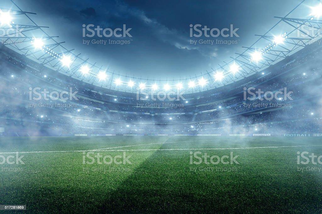 Dramatic football stadium with fog stock photo