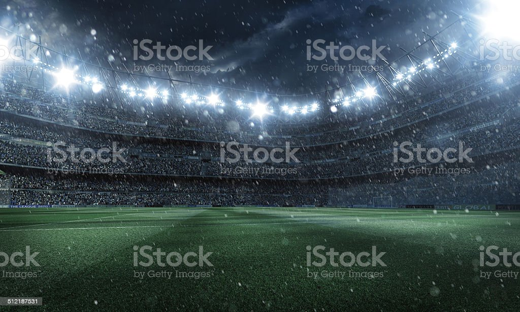 Dramatic football stadium with rain stock photo
