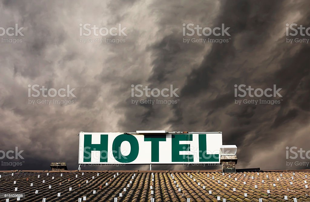 Dramatic hotel sign stock photo