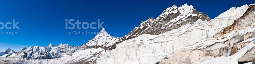 Dramatic icefall panorama snow mountain summits glacier crevasses Himalayas Nepal stock photo