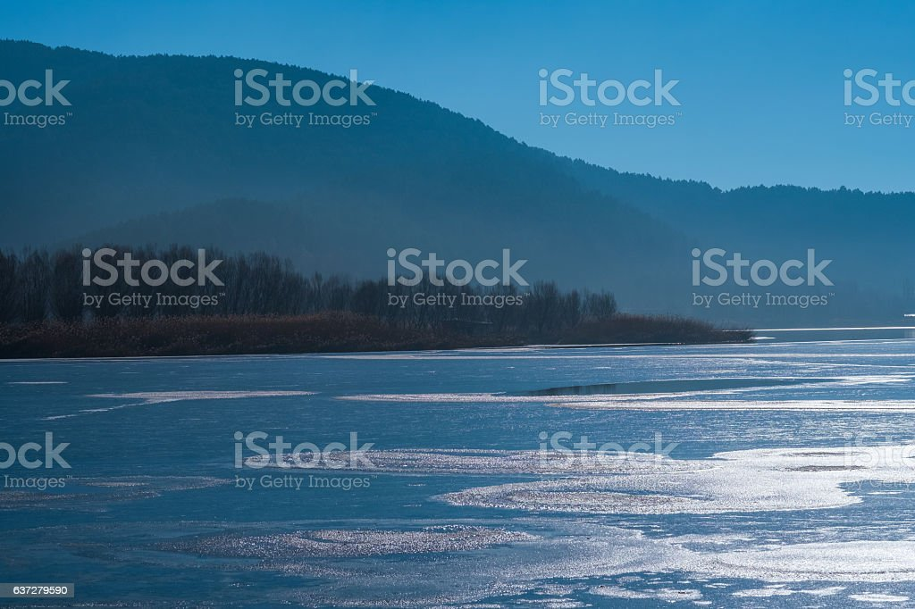 Dramatic lake view in winter time stock photo