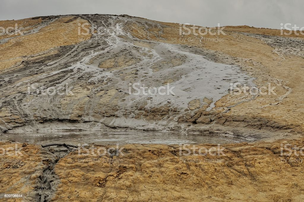 Dramatic landscape of muddy volcanoes. Seems to be lunar landscape. stock photo