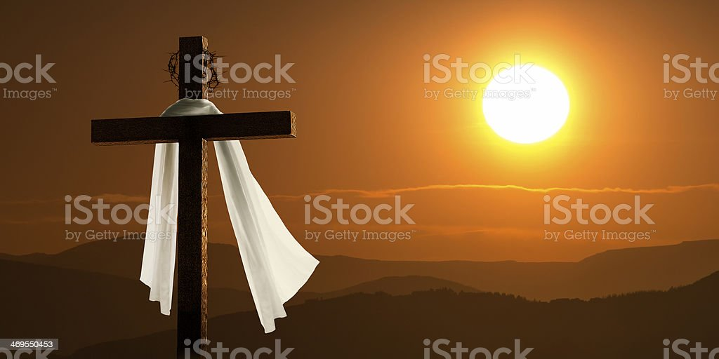Dramatic Lighting Of Mountain Sunrise With Easter Cross stock photo