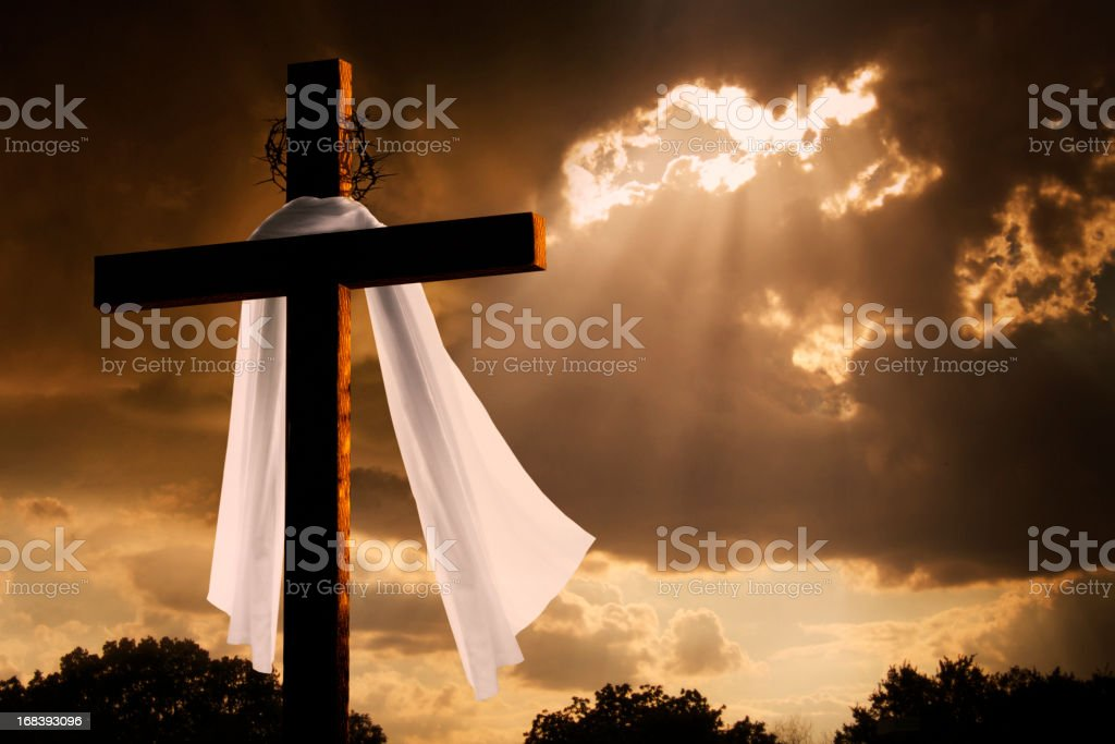 Dramatic Lighting on Christian Easter Cross As Storm Clouds Break stock photo