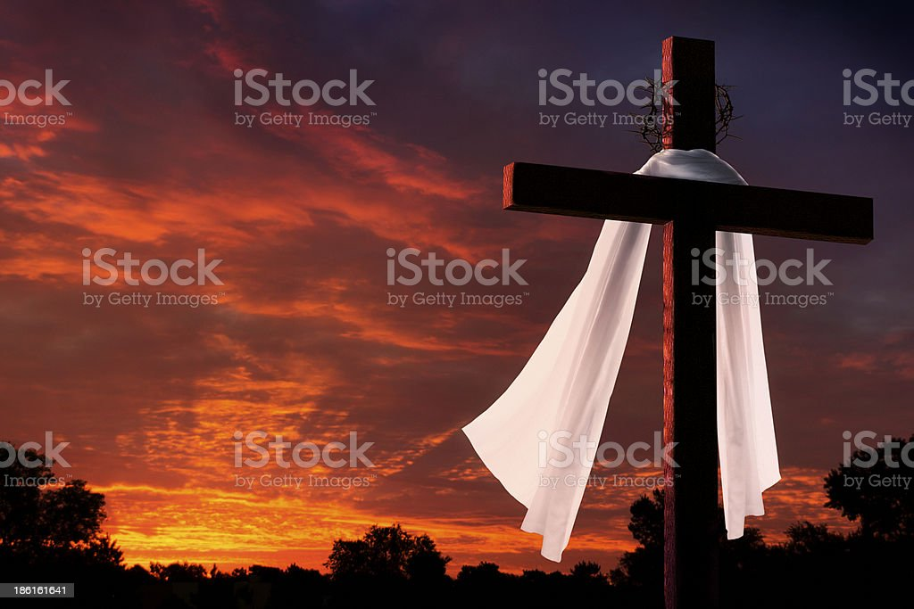 Dramatic Lighting on Christian Easter Morning Cross At Sunrise stock photo
