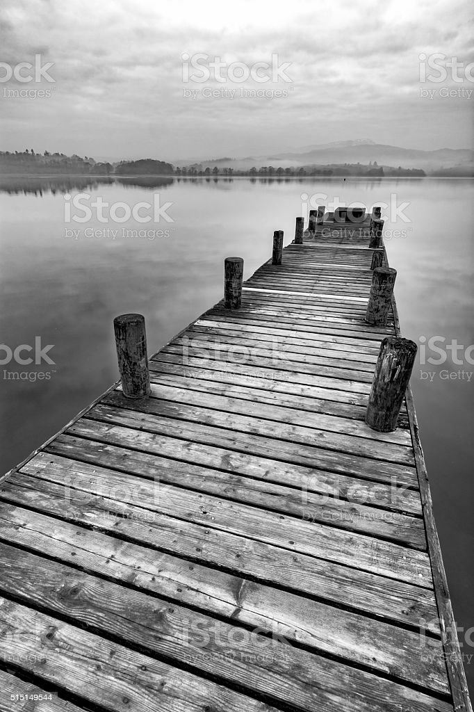 Dramatic Long Wooden Jetty At Windermere In The Lake District. stock photo
