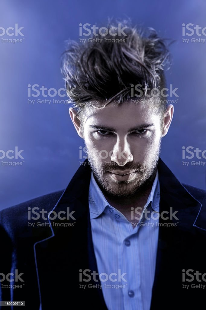 Dramatic look of male fashion model stock photo