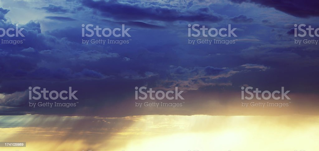 Dramatic Majestic Sunset with Heavy Rain royalty-free stock photo
