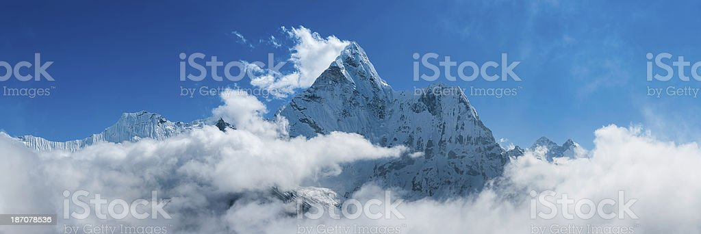 Dramatic mountain peak above clouds Ama Dablam panorama Himalayas Nepal royalty-free stock photo