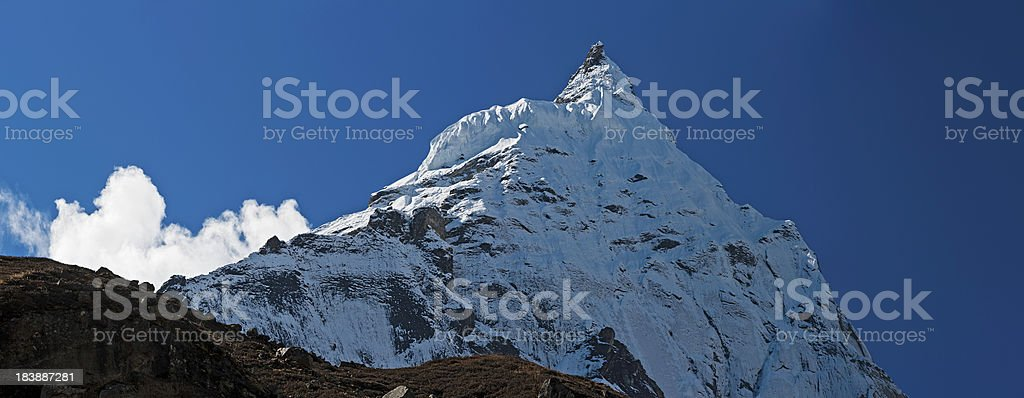 Dramatic mountain peak pinnacle panorama snow glacier summit Himalayas Nepal stock photo