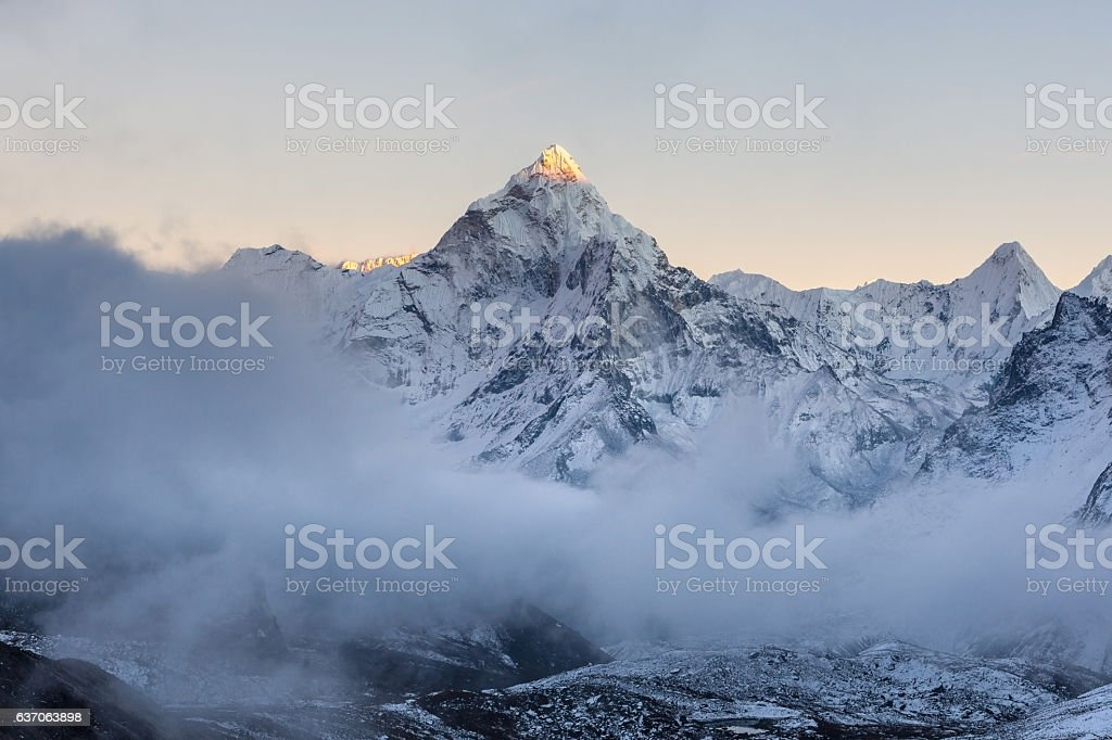 Dramatic mountain view of Ama Dablam summit on the stock photo