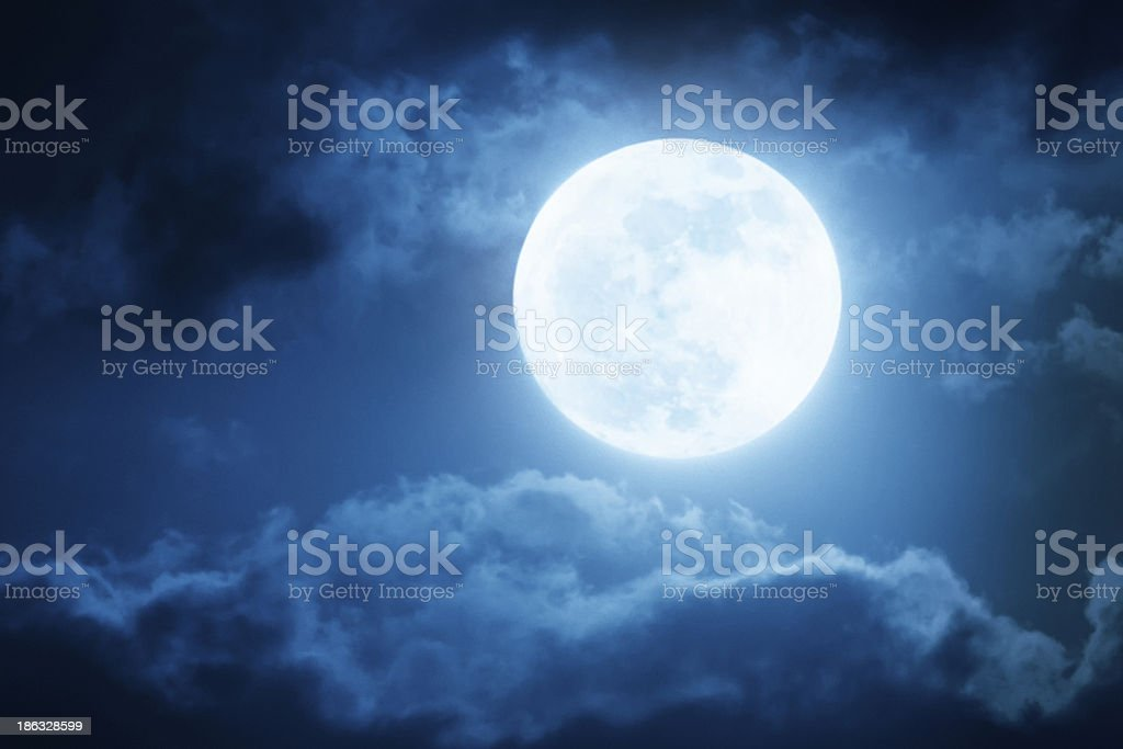 Dramatic Nighttime Sky and Clouds With Large Full Moon stock photo
