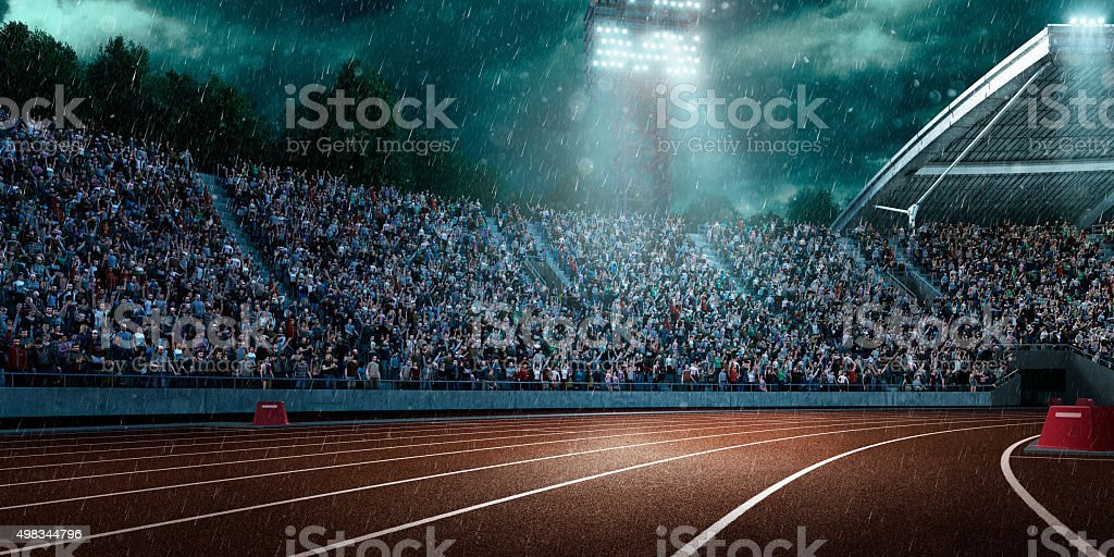 Dramatic olympic stadium with rain stock photo