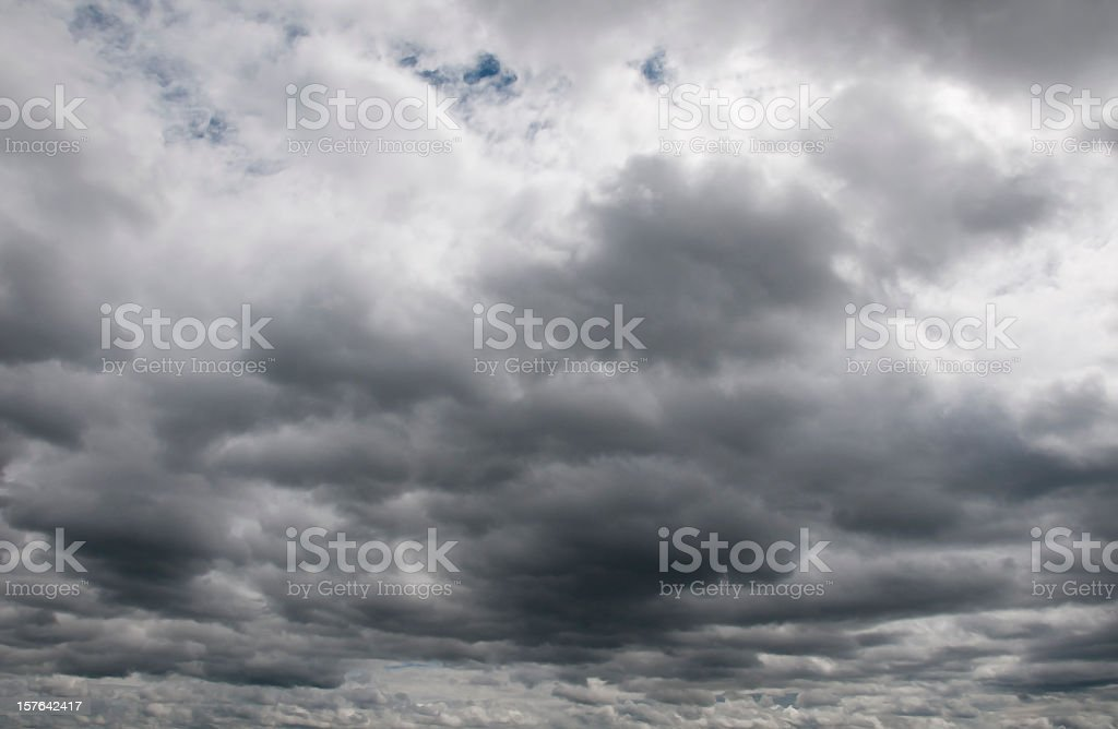 Gloomy and overcast, many dark clouds up to the horizon, little...