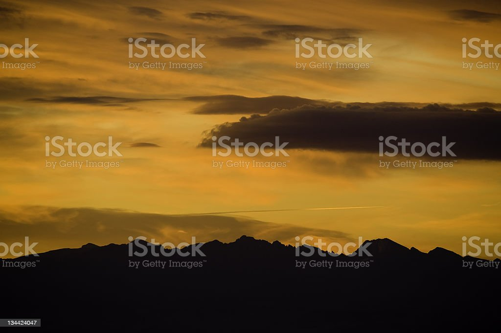 Dramatic Orange Sky and Silhouetted Mountain Range royalty-free stock photo