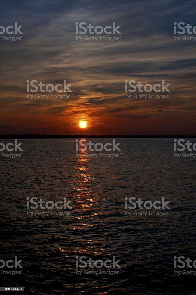 Dramatic orange sunset on dark sky with clouds stock photo