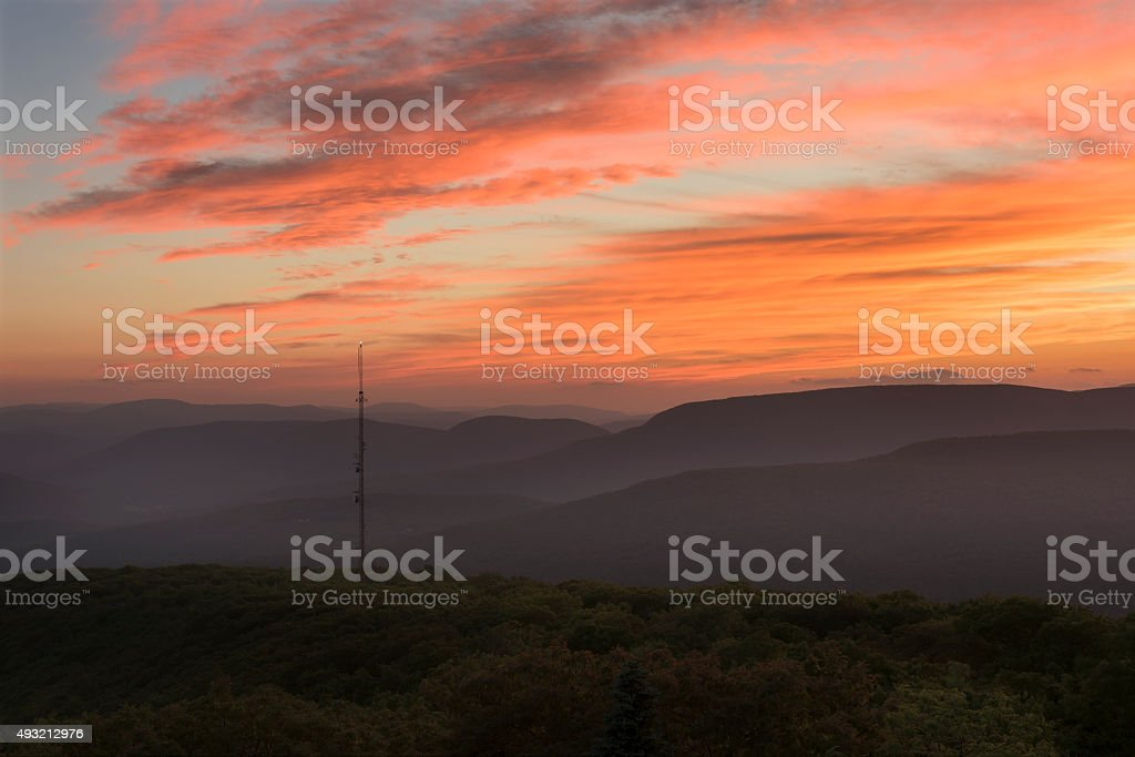 Dramatic Orange Sunset over the Southern Catskill Mountains stock photo