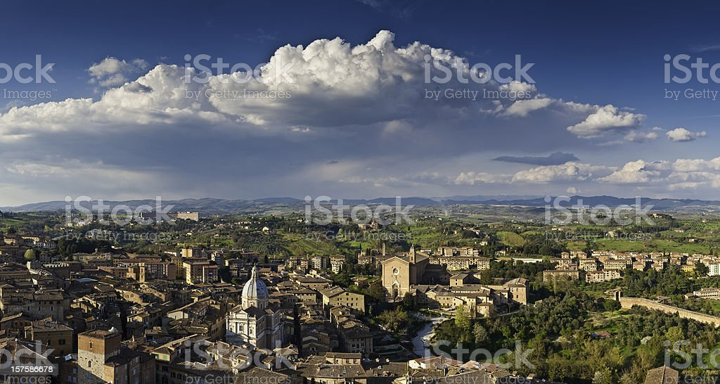 Dramatic panoramic cloudscape over picturesque Tuscany city of Siena Italy royalty-free stock photo