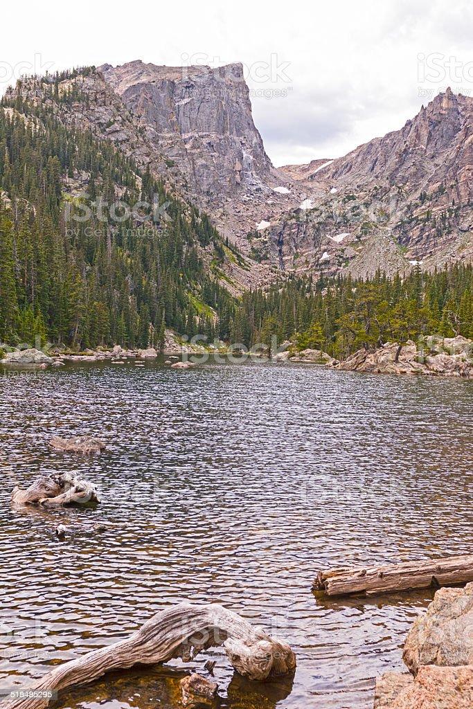 Dramatic Peak over an Alpine Lake stock photo