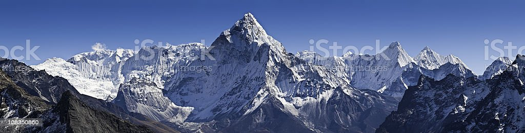 Dramatic peaks pinnacles snowy summits high altitude mountain panorama Himalayas stock photo