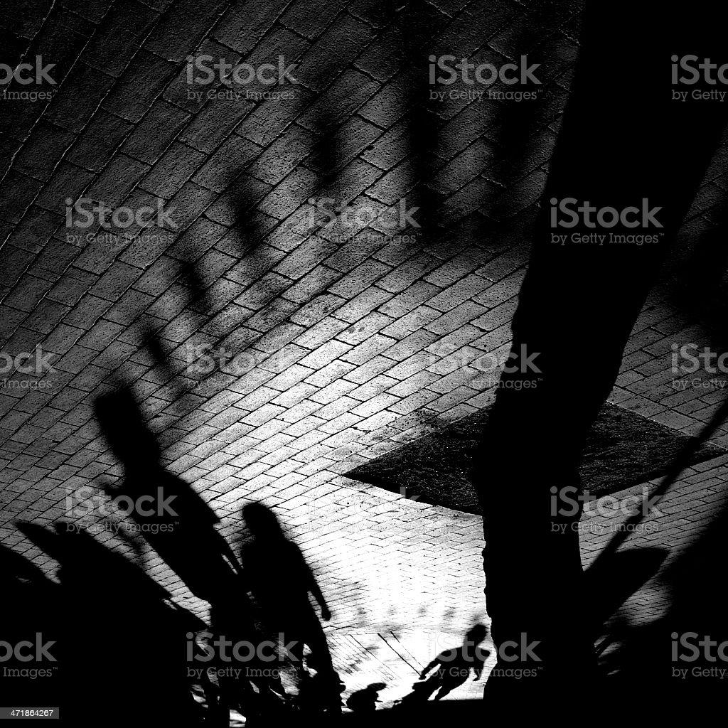 Dramatic Pedestrian Shadows royalty-free stock photo