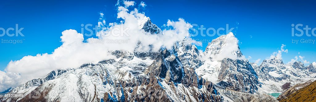 Dramatic pinnacles Taboche 6501m Cholatse 6440m Himalaya mountains panorama Nepal stock photo
