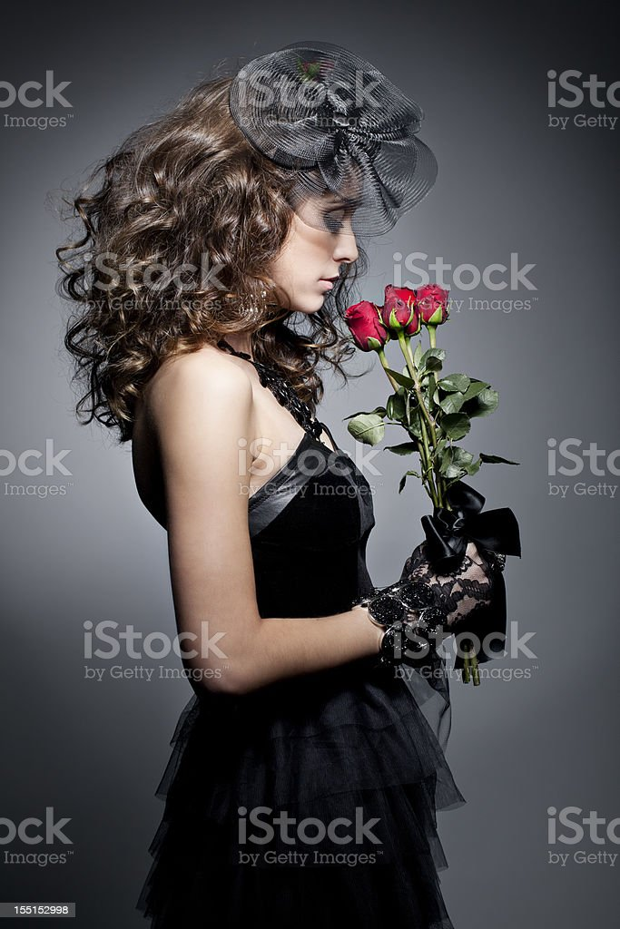 Dramatic portrait of a woman at funeral stock photo