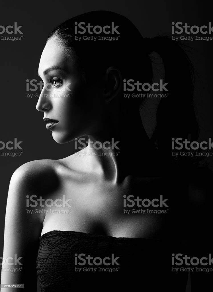 Dramatic portrait of beautiful young woman. Black and white stock photo