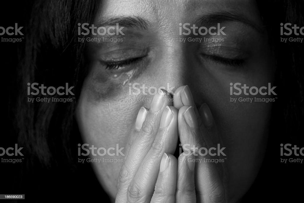 Dramatic portrait of female victim of domestic violence stock photo