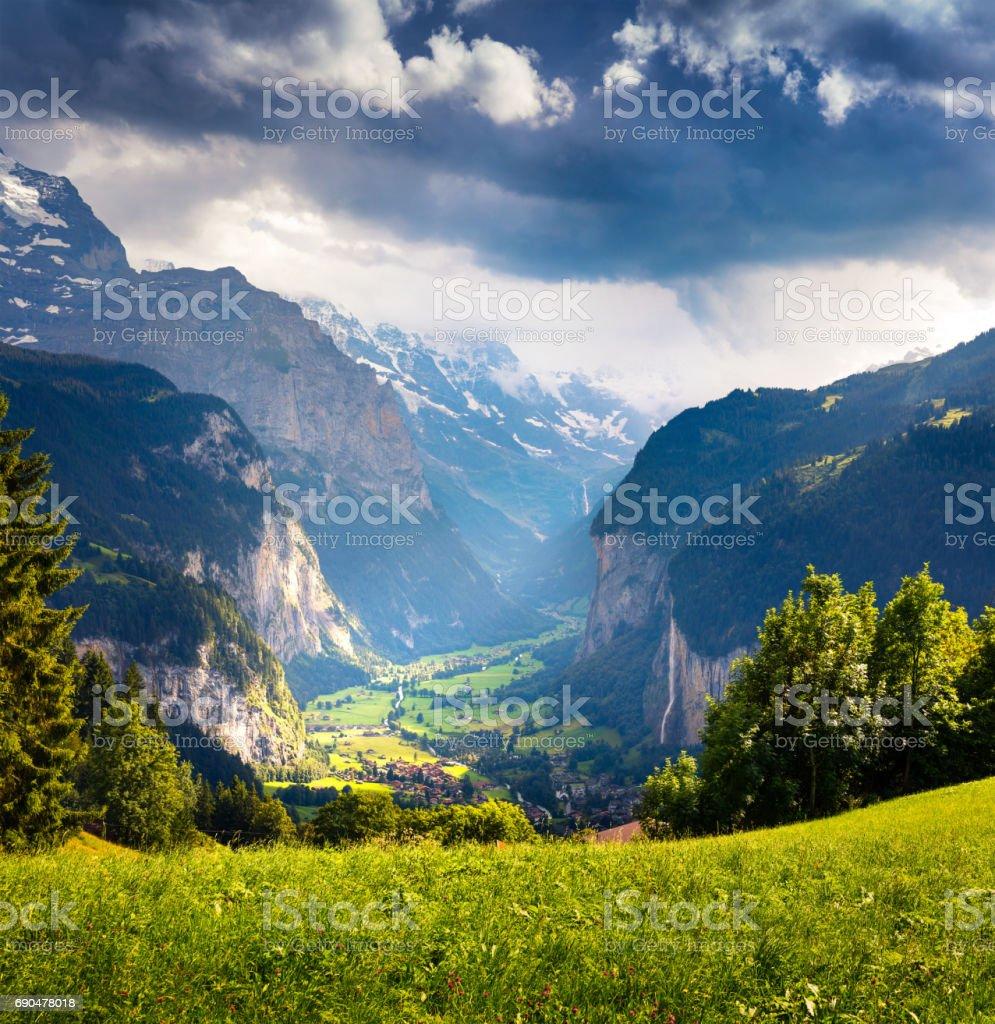 Dramatic rainy view of Lauterbrunnen village. stock photo