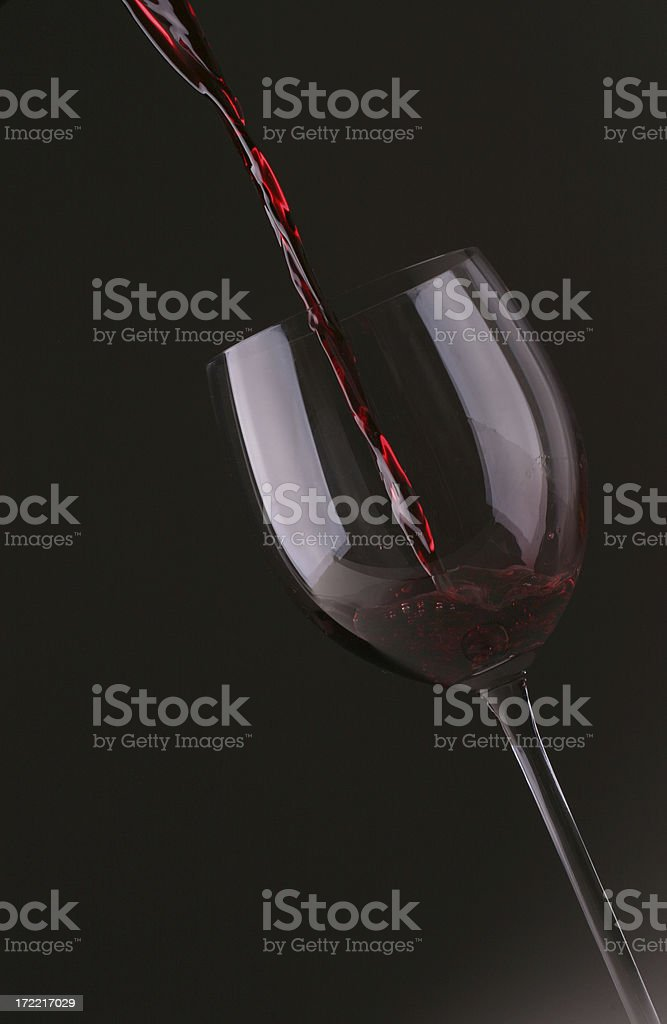 Dramatic Red Wine Pour royalty-free stock photo