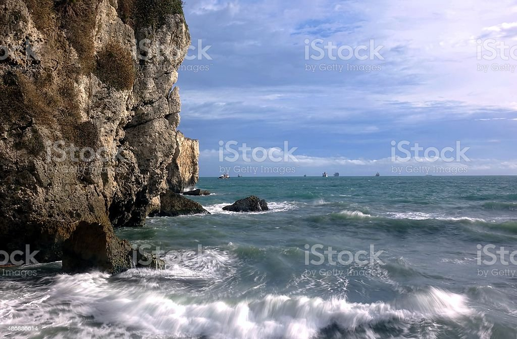 Dramatic Rocky Cliffs and Ocean Scene stock photo