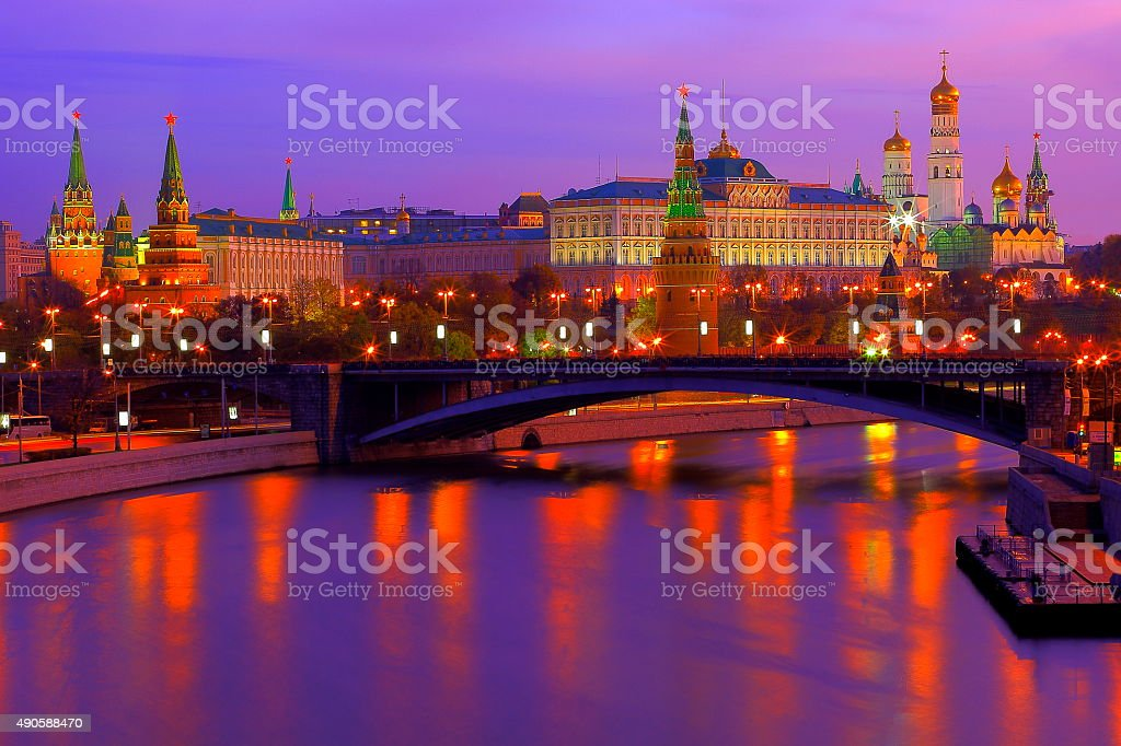 Dramatic Russian Kremlin, Red Square, colorful sunrise bright reflection, Moscow stock photo