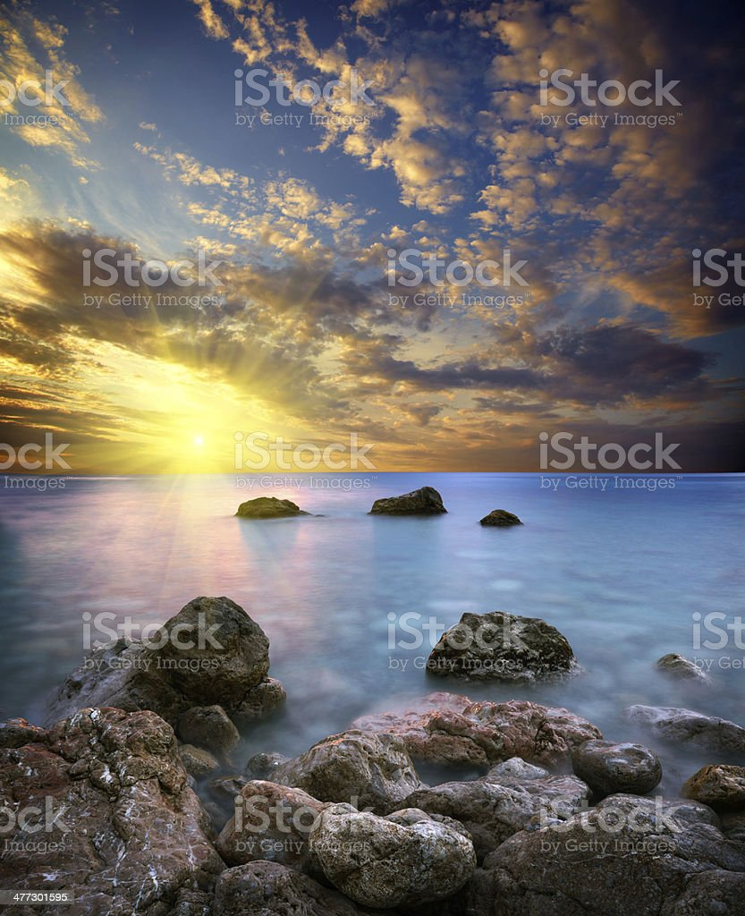 Dramatic sea sunset stock photo