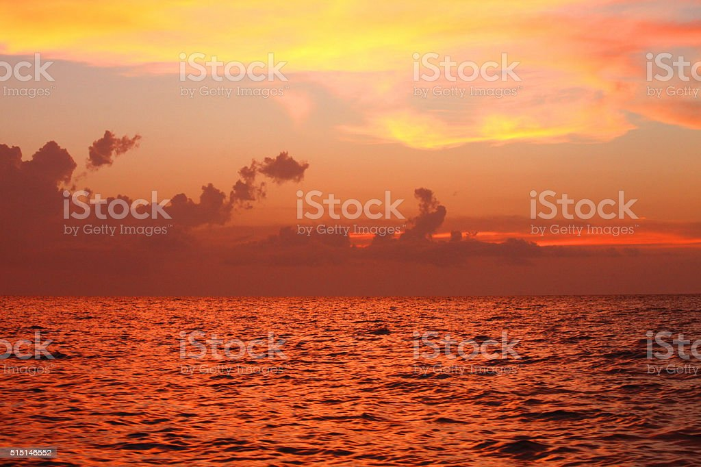 Dramatic seascape: sunset light from a boat stock photo