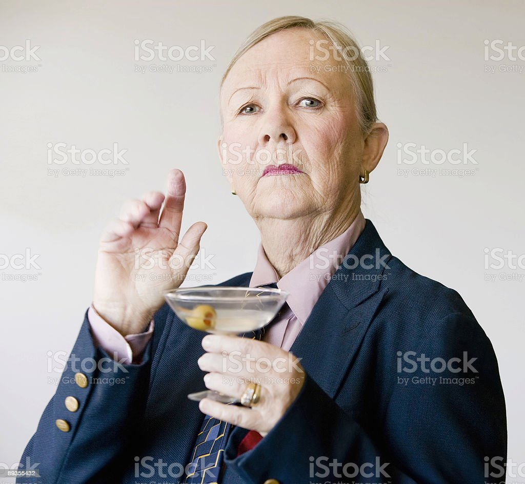 Dramatic Senior Woman with a Martini stock photo