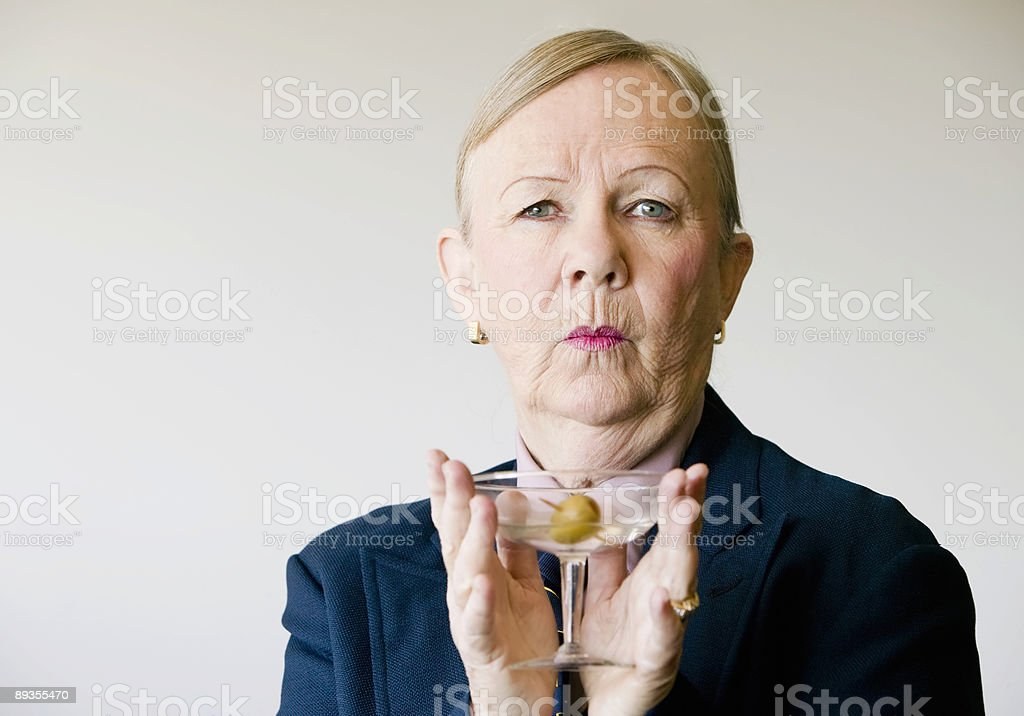 Dramatic Senior Woman with a Martini royalty-free stock photo