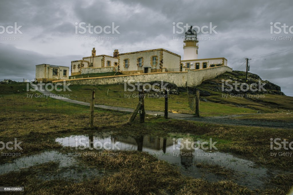 Dramatic shot of Neist Point Lighthouse in Skye stock photo