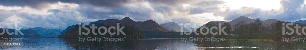 Dramatic skies over mountains and lake stock photo
