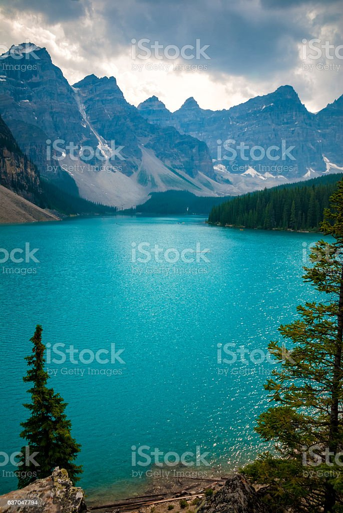 Dramatic sky above Moraine lake in Banff, Canada stock photo