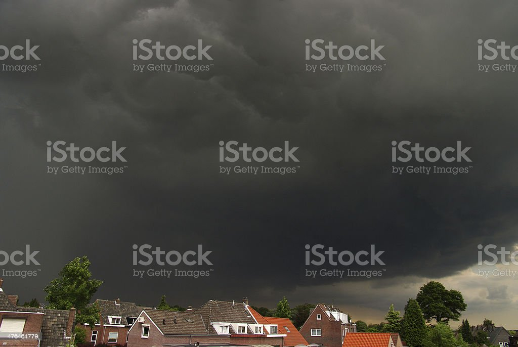 Dramatic sky above the village royalty-free stock photo
