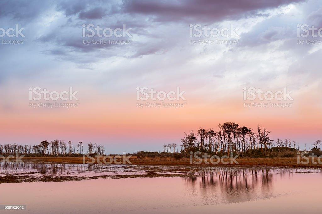 Dramatic Sky Along Coastal Inlet at Sunset stock photo