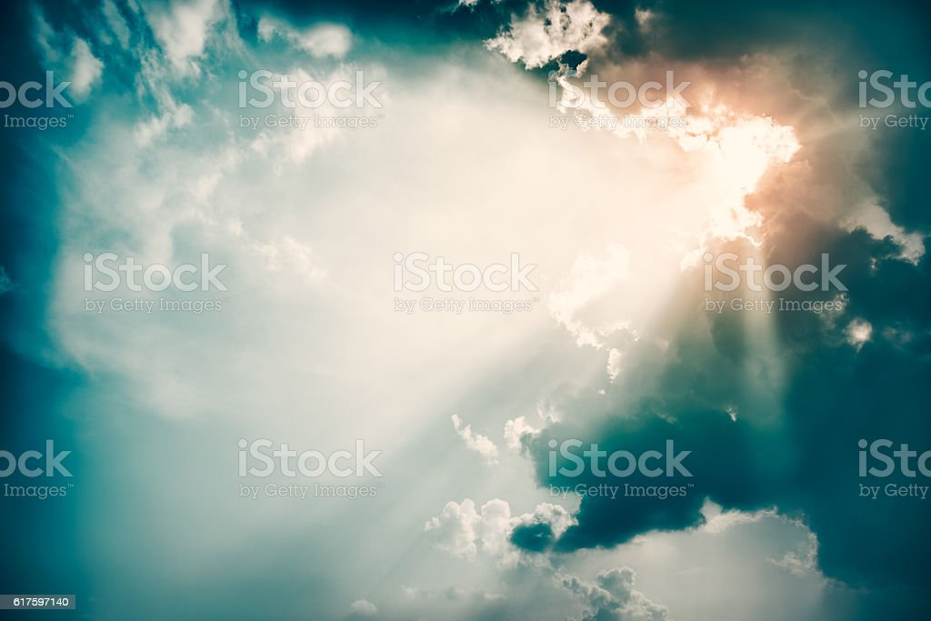 Dramatic Sky and Sun Rays Background. Toned Photo. stock photo